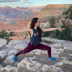 Lori practicing the art of yoga